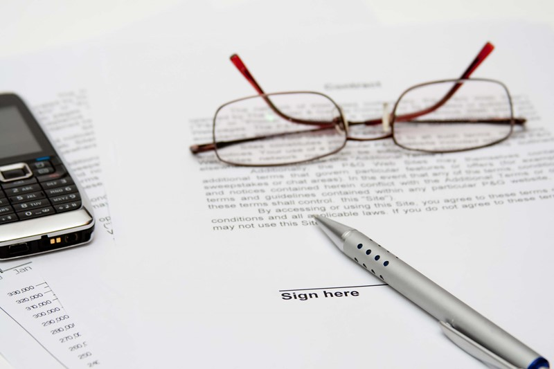 Glasses and a pen on documents